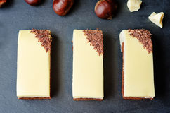 Chestnut brownie cake with chestnut  white chocolate mousse Royalty Free Stock Images