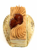 Chestnut cake. Upper view of a piece of tasty chestnut cake over white background Stock Images