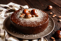 Chestnut cake with almonds and chocolate. Delicious chestnut cake with almonds and chocolate glaze stock photography