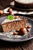 Chestnut cake with almonds and chocolate. Delicious chestnut cake with almonds and chocolate glaze royalty free stock photography