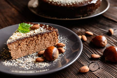 Chestnut cake with almonds and chocolate. Delicious chestnut cake with almonds and chocolate glaze Royalty Free Stock Photos