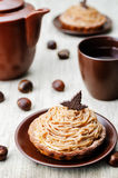 Chestnut cake Mont Blanc. On a brown background. toning. selective Focus stock images
