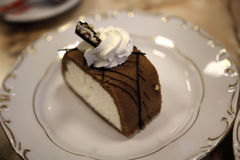 Chestnut cake. A chestnut cake slice on a white plate royalty free stock image