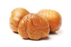 Chestnut. Chinese food, peeled roasted chestnut on white background Stock Images