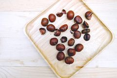 Chestnut in dish Wooden on the Table. Wood Royalty Free Stock Photos
