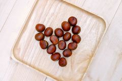 Chestnut in dish Wooden on the Table. Wood Stock Photography