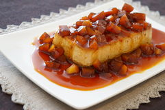 Chestnut Flan. With caramel sauce on a white plate Royalty Free Stock Photos