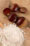 Chestnut flour in a wooden spoon stock photo