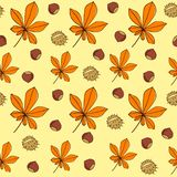 Chestnut leaves and fruits. Seamless vector pattern. Leaves and fruits are hand-drawn on a yellow background. Seamless pattern stock illustration