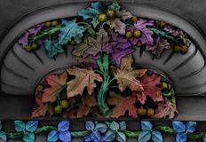 The chestnut leaves. Shot in black and white and painted in colors. Sculpture on the facade of this classic building representing some flowers. Placed in Royalty Free Stock Photo