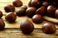 Chestnut on rustic wooden table Stock Photo