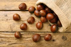 Chestnut  on rustic wooden table Stock Photos