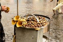 Chestnut seller in the street. Stock Images