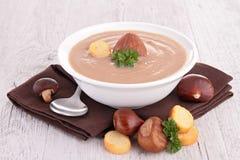 Chestnut soup. Bowl of creamy chestnut soup stock photo