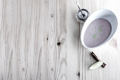 Chestnut soup with milk and cinnamon. On white board Stock Photo