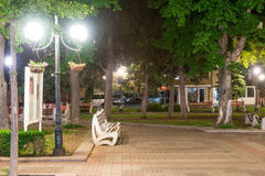 Chestnut square in the center of the night city of Pomorie in Bulgaria stock photography