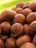 Chestnut texture background. A pile of baking chestnut on green background royalty free stock photo