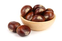 Chestnut in a wooden bowl isolated on white background. Top view.  royalty free stock image