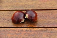 Chestnut on a wooden table Stock Photography
