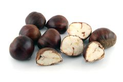 Chestnuts 1. Whole and cut chestnuts on a white background Stock Images