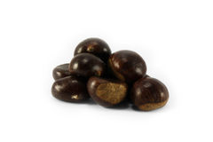 Chestnuts. A handful of edible chestnuts Stock Images