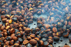 Chestnuts. Shot of chestnuts being prepared on fire Royalty Free Stock Image
