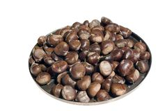 Chestnuts. Isolated on white background Stock Photo