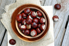 Chestnuts. Wooden bowls filled with chestnuts Stock Image
