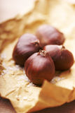 Chestnuts. Roasted salted chestnuts in classic paper wrapping Stock Photo