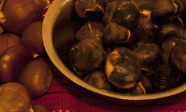 Chestnuts arrangement. Closeup of chestnuts on retro background Royalty Free Stock Image