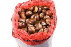 Chestnuts in a bag. On white background royalty free stock photo