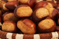 Chestnuts in a basket. Big chestnuts in a basket Stock Photo