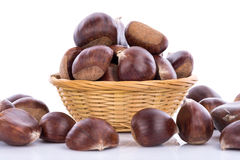 Chestnuts in a basket. Isolated on white Stock Image