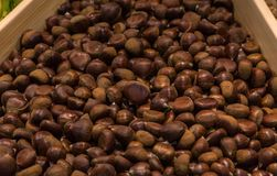 Chestnuts in basket in supermarket, first-person view royalty free stock photo