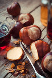 Chestnuts and bottle with tincture Stock Photos