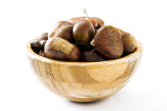 Chestnuts in a bowl. Isolated on white background Royalty Free Stock Images
