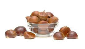 Chestnuts (Castanea sativa) in a glass bowl Stock Photos