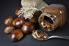 Chestnuts and a chocolate cream in little jars Royalty Free Stock Photos