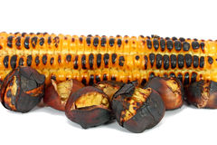 Chestnuts and corn cob Stock Photos
