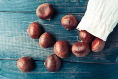 Chestnuts in cotton bag Stock Images