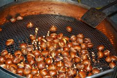 Chestnuts and flames, close up royalty free stock photography