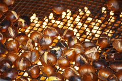 Chestnuts with flames. Cooking in october Royalty Free Stock Photo