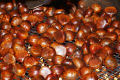 Chestnuts on flames and smoke Stock Photo