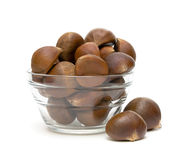 Chestnuts in a glass bowl on a white background royalty free stock photos