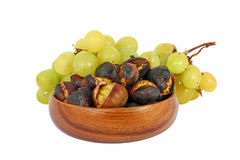 Chestnuts and grapes stock images