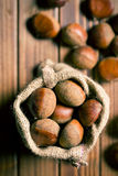 Chestnuts in jute bag Stock Images