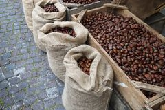 Chestnuts in a jute sack. At the city market with a street baclground Stock Photo