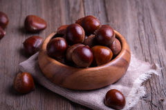 Chestnuts on the old wooden table Royalty Free Stock Images