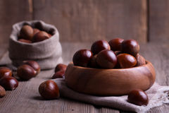 Chestnuts on the old wooden table Royalty Free Stock Photography