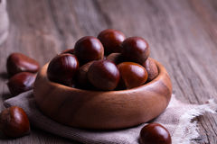 Chestnuts on the old wooden table Stock Photo